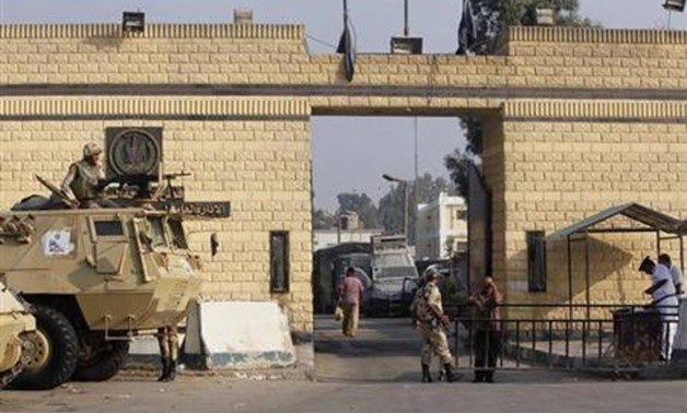 Egyptian army soldiers guard with armoured personnel carriers (APC) in front of the main gate of Torah prison on the outskirts of Cairo, August 22, 2013.