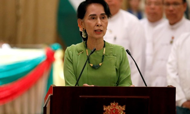 FILE PHOTO: Myanmar State Counselor Aung San Suu Kyi talks during a news conference with India's Prime Minister Narendra Modi in Naypyitaw, Myanmar September 6, 2017. REUTERS/Soe Zeya Tun