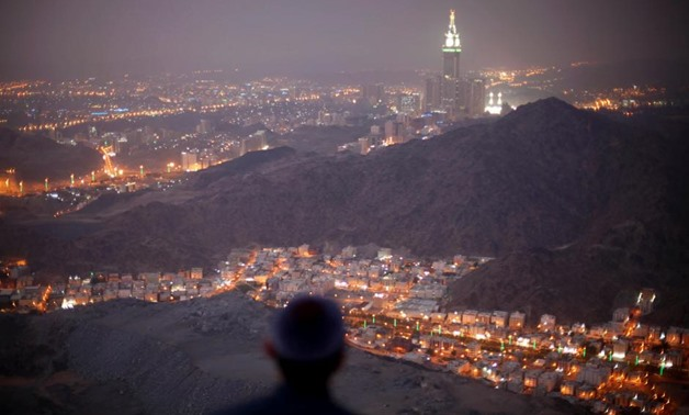 A Muslim pilgrim prays atop Mount Thor in the holy city of Mecca ahead of the annual haj pilgrimage October 11, 2013. REUTERS