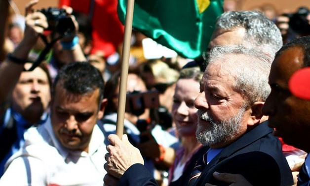 Brazilian President Luiz Inacio Lula da Silva (C) arrives at the Federal Justice office to be questioned by anti-corruption judge Sergio Moro, in Curitiba, southern Brazil, on September 13, 2017AFP