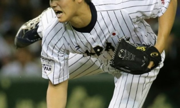 JIJI PRESS/AFP/File | Nippon Ham Fighters pitcher Shohei Otani, pictured in 2015, will have the opportunity to play Stateside between November and March when his team makes him available for bids from Major League Baseball teams