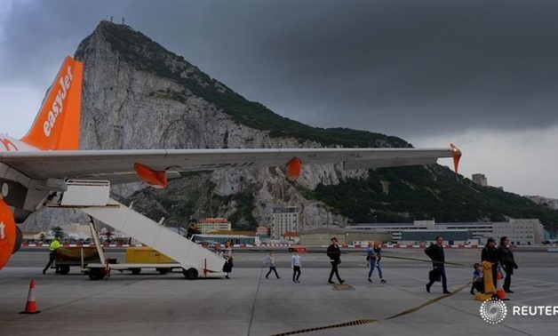 Passengers disembark from an EasyJet flight after arriving at Gibraltar airport in Gibraltar, April 19, 2017. REUTERS/Phil Noble