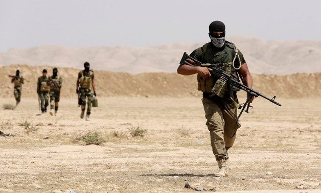 Fighters with Asaib Ahl al-Haq, a Shiite militia, and Kurdish pesh merga forces on patrol earlier this month in Tikrit, Iraq. REUTERS.Youssef Boudlal