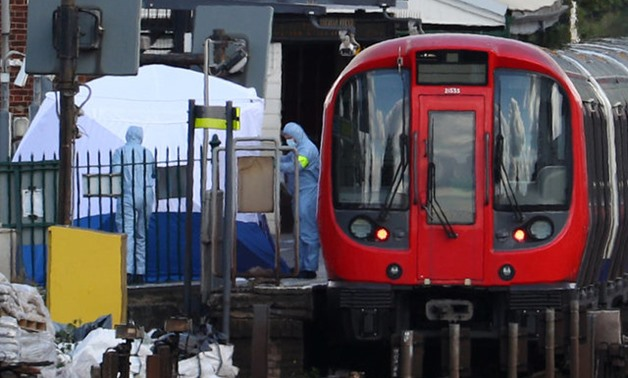 Forensic investigators search on the platform at Parsons Green tube station in London - REUTERS