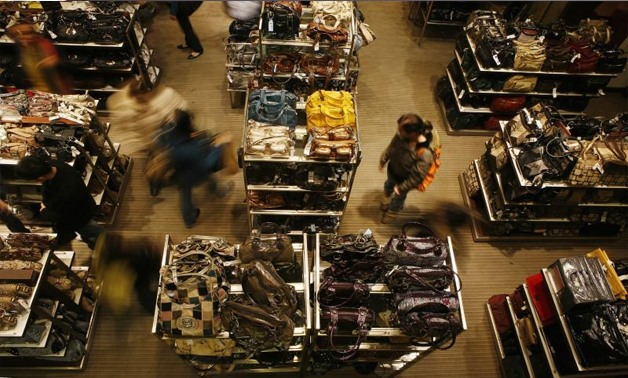 Shoppers walk through Macy's department store in New York November 20, 2007 - REUTERS/Lucas Jackson