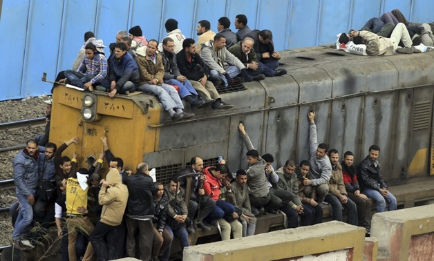 People travel on an overcrowded train in Cairo, Egypt in 2013 - Reuters