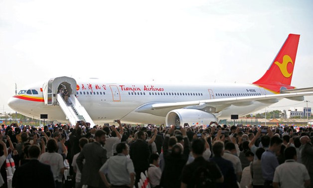 People look at the first Airbus A330 plane to be delivered from Airbus' Chinese completion plant for A330 jets to Tianjin Airlines, during the inauguration ceremony of the plant, in Tianjin, China September 20, 2017. REUTERS/Stringer ATTENTION EDITORS - T