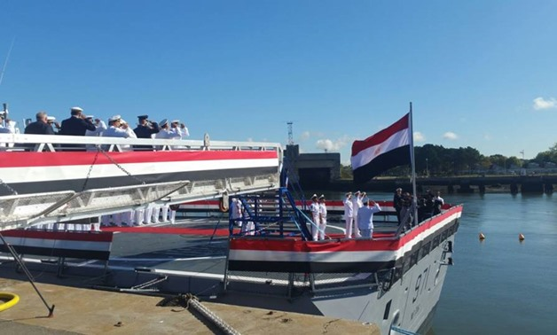 Egyptian Navy Commander Ahmed Khaled raises flag on Gowind 2500 Corvette in Lorient shipyard- press photo