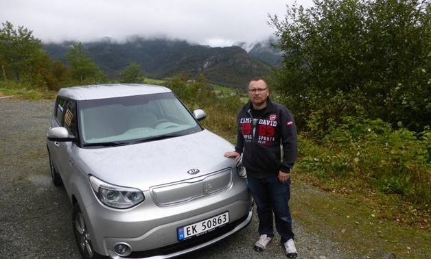 Heiko Hauschulz poses next to his electric car in a remote village in Hjelmeland, Norway September 7, 2017. Picture taken September 7, 2017. REUTERS/Alister Doyle