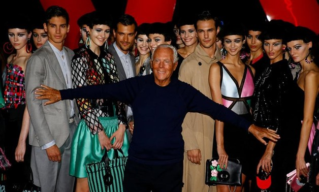 Italian designer Giorgio Armani acknowledges applause at the end of his Spring/Summer 2018 show at the Milan Fashion Week in Milan, Italy. REUTERS/Stefano Rellandini