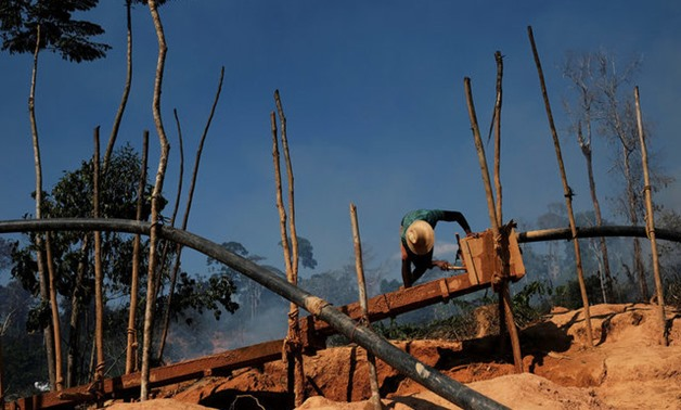 Brazilians toil for gold in illegal Amazon mines - REUTERS