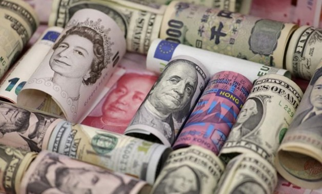 Euro, Hong Kong dollar, U.S. dollar, Japanese yen, British pound and Chinese 100-yuan banknotes are seen in a picture illustration shot January 21, 2016. REUTERS/Jason Lee/Illustration/File Photo