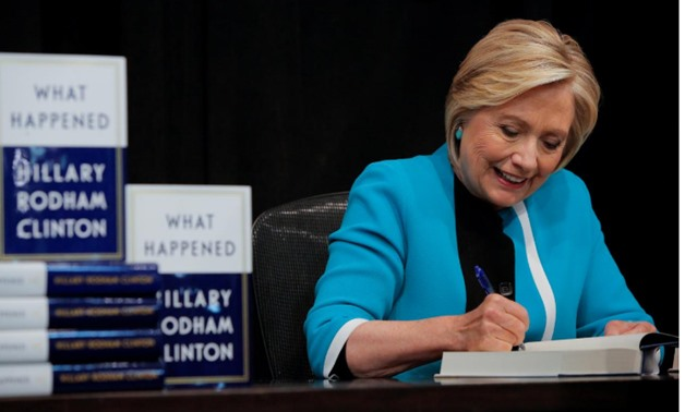 Former Secretary of State Hillary Clinton signs a copy of her new book 'What happened' at Barnes & Noble bookstore at Union Square in Manhattan, New York City, U.S., September 12, 2017. REUTERS/Andrew Kelly