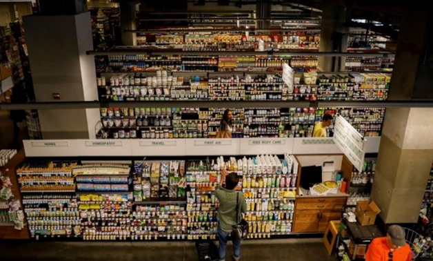 Customers shop at a Whole Foods store in New York City, U.S., August 28, 2017. REUTERS/Brendan McDermid