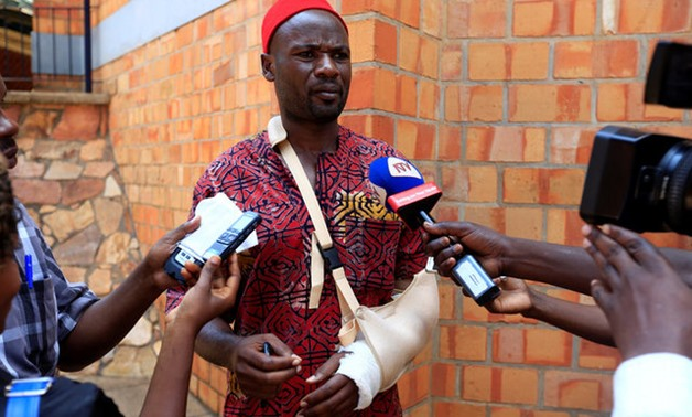 An Ugandan lawmaker Mbwatekamwa Gaffa injured during a fight in the parliament on Wednesday ahead of proposed age limit amendment bill debate, speaks to the media, in Kampala - REUTERS