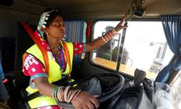 Gulaban, a 25-year old mother of three, adjusts a fan before driving a 60-tonne truck, during a training session of the Female Dump Truck Driver Programme, introduced by the Sindh Engro Coal Mining Company (SECMC), in Islamkot, Tharparkar, Pakistan Septem