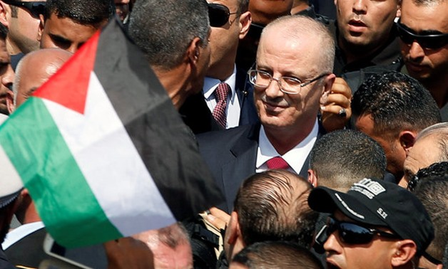 Palestinian Prime Minister Rami Hamdallah arrives to take control of Gaza from the Islamist Hamas group, in the northern Gaza Strip October 2, 2017. REUTERS/Mohammed Salem