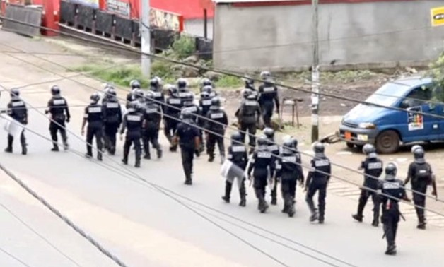 A still image taken from a video shows riot police walk along a street in the English-speaking city of Buea, Cameroon October 1, 2017. via REUTERS TV/File Photo