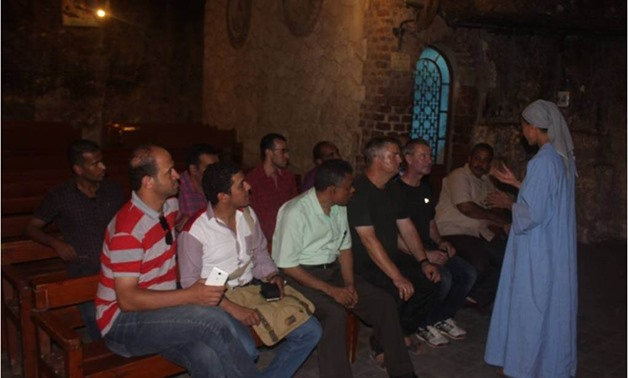 The German delegation in the Monastery of the Virgin at Assiut's West Mountain - Press photo