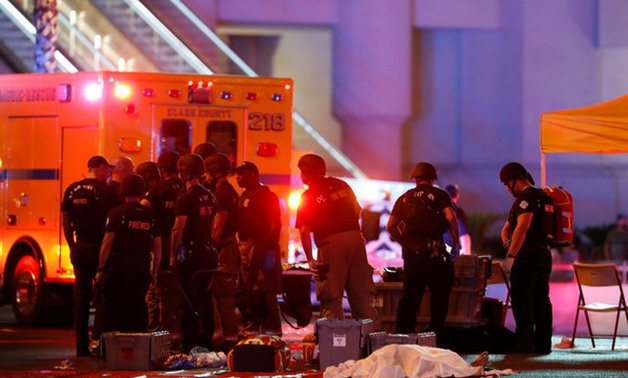 FBI agents confer in front of the Tropicana hotel-casino on October 2, 2017, after a mass shooting during a music festival on the Las Vegas Strip in Las Vegas - REUTERS