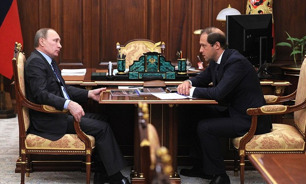 Russian Industry and Trade Minister Denis Manturov with Russian president Vladimir Putin- Photo courtesy of Russian presidency