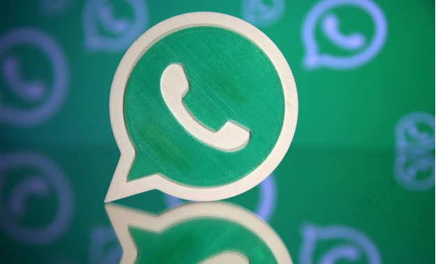 A 3D printed Whatsapp logo is seen in front of a displayed Whatsapp logo in this illustration - REUTERS