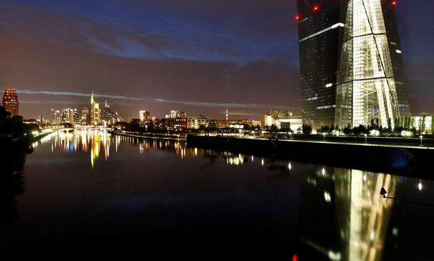 The skyline, with its characteristic banking towers and the headquarters of the European Central Bank (ECB, R), are reflected in river Main in Frankfurt, Germany, ctober 1, 2017. REUTERS/Kai Pfaffenbach