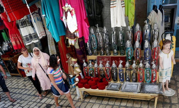 Algerian tourists are seen shopping at the old medina in Sousse - REUTERS