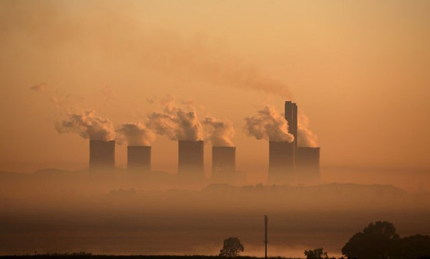 Steam rises at sunrise from the Lethabo Power Station, a coal-fired power station owned by state power utility ESKOM near Sasolburg - REUTERS