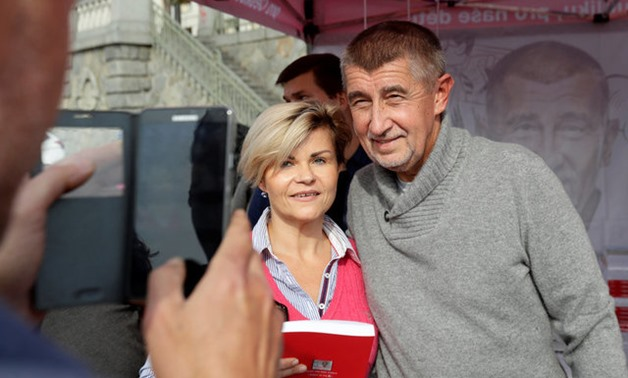 The leader of ANO party Andrej Babis poses for a photo with a supporter during an election campaign rally in Prague, Czech Republic September 28, 2017. REUTERS