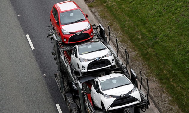 New Toyota cars are transported from their manufacturing facility in Burnaston - REUTERS