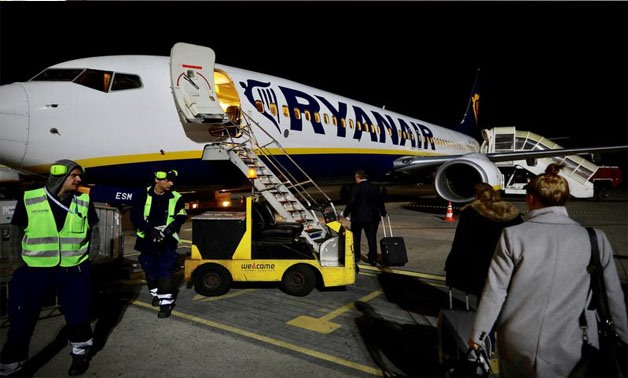 Passengers board a Ryanair flight in Gdansk, Poland September 27, 2017 - REUTERS/Kevin Coombs