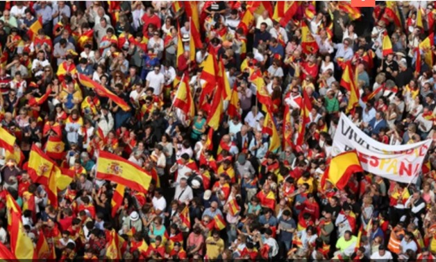 Demonstrators wave Spanish flags and shout in front of city hall during a demonstration in favour of a unified Spain a day before a banned October 1 independence referendum in Catalonia, in Madrid, Spain, Photo - Reuters