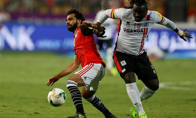 Uganda's Hassan Wasswa in action with Egypt's Mohamed Salah – REUTERS