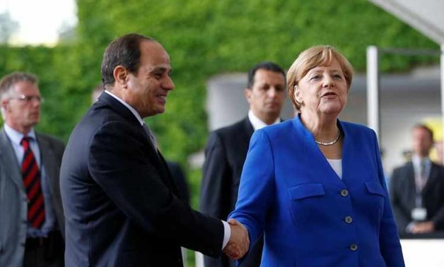 German Chancellor Angela Merkel meets Egypt's President Abdel-Fattah el-Sisi at the Chancellery in Berlin- reuters