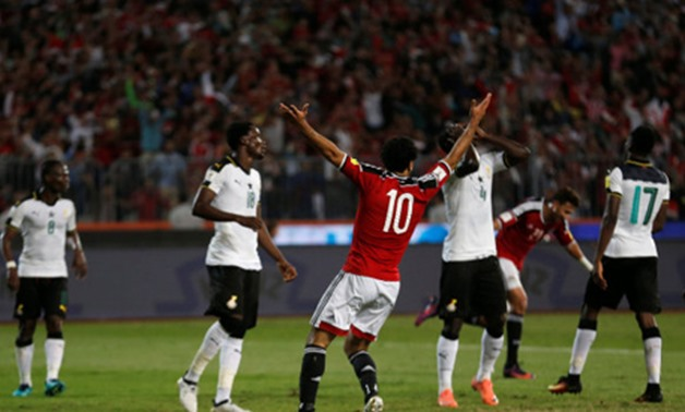 Mohamed Salah with Ghana players in their last match at Borg El Arab Stadium, REUTERS