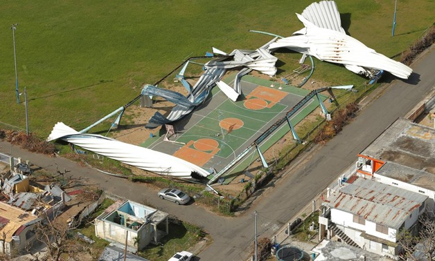 Remains of a shed is scattered over a basketball court after Hurricane Maria near Loiza, Puerto Rico, October 6, 2017. REUTERS/Lucas Jackson