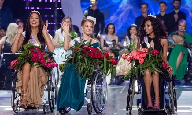 Miss Belarus Aleksandra Chichikova (C), winner of the Miss Wheelchair World beauty pageant, first runner-up Lebohang Monyatsi from South Africa (R) and second runner-up Adriana Zawadzinska of Poland at the awards held in Warsaw