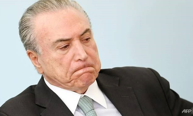 A recent poll found the center-right government of President Michel Temer, pictured here, is seen as doing a good or very good job by only three percent of the population. - AFP