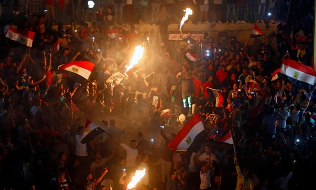 Egyptians celebrate their victory in a soccer match against Congo that qualifies Egypt for the World Cup, in Cairo, Egypt October 8, 2017. REUTERS/Mohamed Abd El Ghany