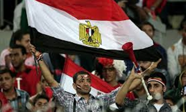 An Egyptian supporter waves a national flag during the World Cup qualifying playoff second leg soccer - CC