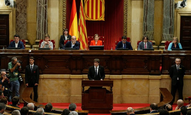Catalan President Carles Puigdemont delivers a speech in the Catalan regional parliament in Barcelona, Spain, October 10, 2017. REUTERS