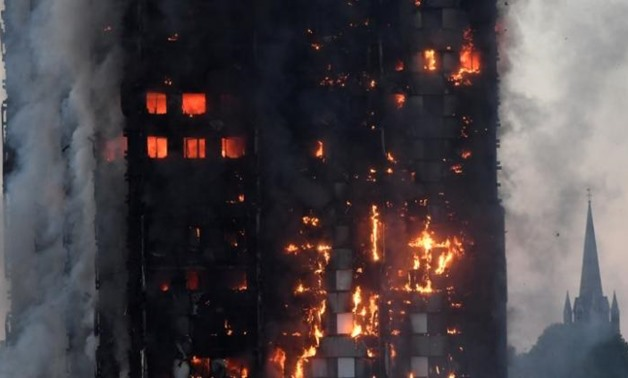 Flames and smoke engulf a tower block, in north Kensington, West London, Britain - REUTERS