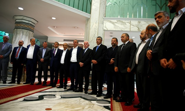 Hamas and Fatah delegations in Cairo announcing their agreement deal as part of reconciliation talks held under the auspices of Egypt Thursday, Oct.12, 2017 - Reuters