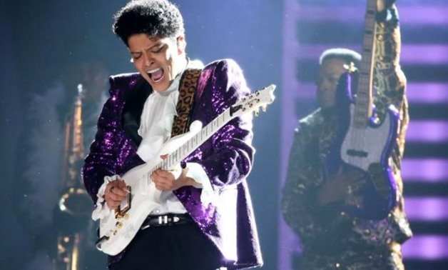 "Bruno Mars performs ""Let's Go Crazy"" during a tribute to the late singer Prince at the 59th Annual Grammy Awards in Los Angeles - REUTERS"