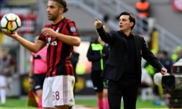 AC Milan's head coach Vincenzo Montella shouts instructions during their Italian Serie A match against Udinese, at the San Siro stadium in Milan - AFP