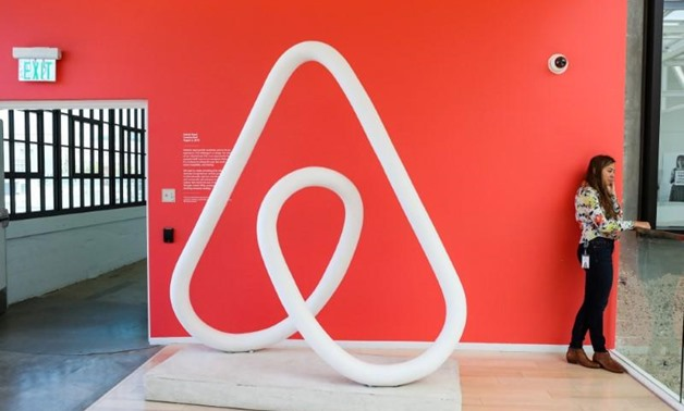 A woman talks on the phone at the Airbnb office headquarters in the SOMA district of San Francisco, California, U.S., REUTERS - Gabrielle Lurie