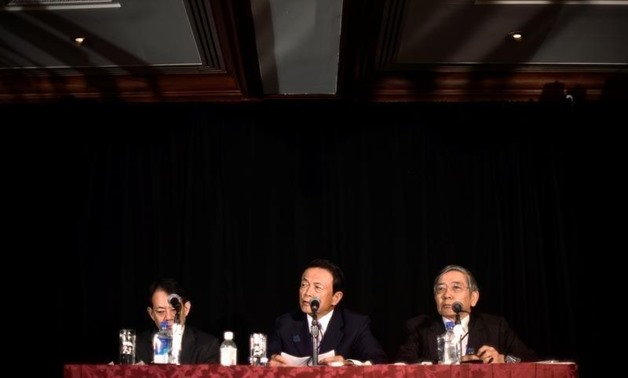 Japanese Vice Finance Minister Masatsugu Asakawa, Finance Minister Taro Aso, and Bank of Japan Governor Haruhiko Kuroda take questions from reporters at the annual meetings of the IMF and World Bank Group in Washington October 7, 2016 - REUTERS
