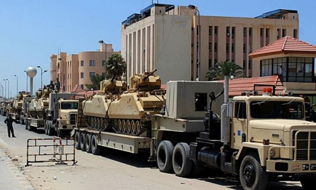 File picture shows an Egyptian military convoy in the North Sinai provincial capital El-Arish - AFP