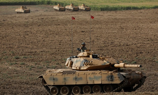 urkish Army tanks and armoured personnel carriers (APC) manoeuvre during a military exercise near the Turkish-Iraqi border in Silopi, Turkey, September 25, 2017. REUTERS/Umit Bektas